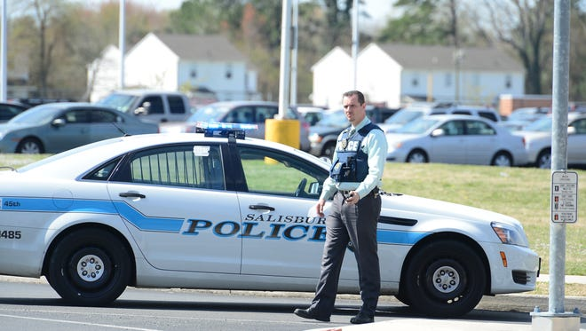 Police cars block the entrance to Bennett High School on West College Ave. on Wednesday, April 5, 2017 following an incident involving multiple students.