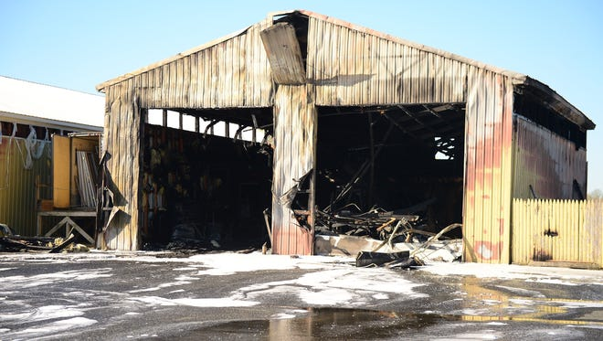 A structure fire at Dukes Lumber Yard in Laurel left the building smoldering early on Monday, April 10.
