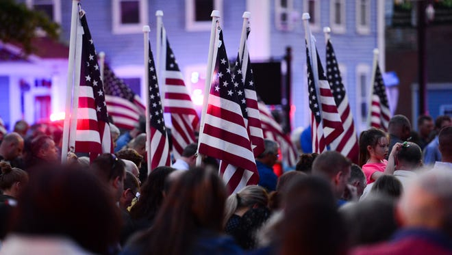 A candle vigil was held in honor of fallen Delaware State Police officer Cpl. Stephen J. Ballard at the Square in Georgetown on Monday, May 1, 2017.