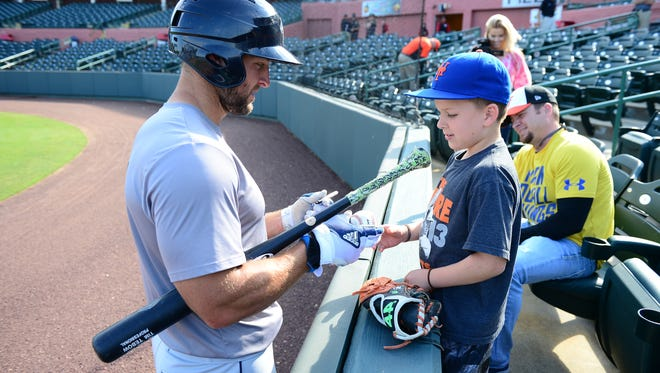 Columbia Fireflies Tim Tebow stops by to sign Tyler Hunt's baseball during batting practice at Perdue Stadium on Wednesday, May 10, 2017.