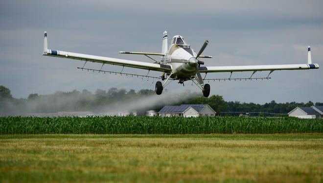 "William ""Dusty"" Hall pilots his Crop Dusting plane at the Laurel Airport on Wednesday, June 7, 2017."