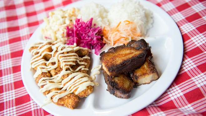 A combo plate with Pork Belly Adobo and Mochi Nori fried chicken from Poi Dog Snack Shop in Philadelphia.