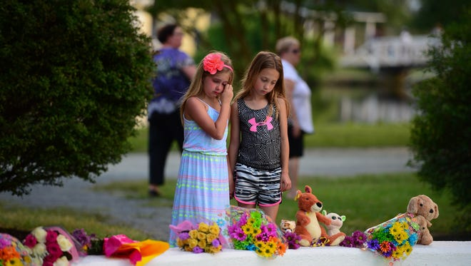 Members of the community gathered on Monday, June 12, 2017 at the Salisbury Park Fountain for a silent vigil in honor of Brooke Mulford, who passed away Monday morning.