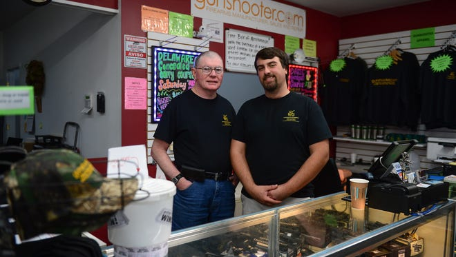 Rodger Perry and Grandson Connor Perry stand in their new Gunshooter Enterprise location in downtown Millsboro, DE. on Thursday, June 22, 2017.