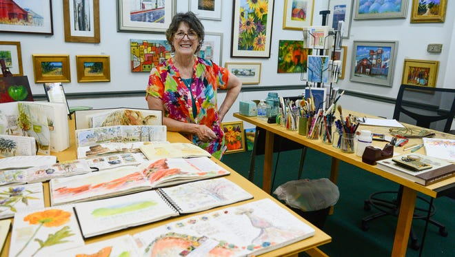 Rosemary Connelly stands in her Milford Art Studio Thursday, July 6, 2017. With the passing of her husband Bob, Connelly is ready to make a change and close the studio— she hopes to be out by the end of August or beginning of September— and is focusing on something that is a passion of hers: watercolor journaling.