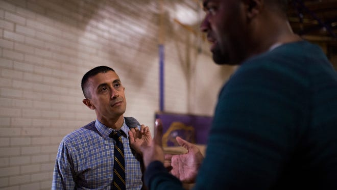 Assemblyman Art Barclay, right, speaks with superintendent Paymon Rouhanifard inside the Camden High School gym Tuesday, Aug. 29, 2017 in Camden.