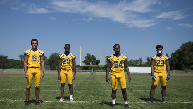 Buena running backs Chris Doughty, from left, Byron Spellman, Jaden Roberts and Shawn Rice pose for a portrait Thursday, Aug. 24, 2017 at Buena Regional High School.
