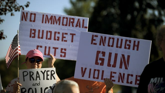 Protestors gather during a demonstration for more gun control to help prevent gun violence outside Rep. Tom MacArthur's district office Wednesday, Oct. 4, 2017 in Marlton, New Jersey.
