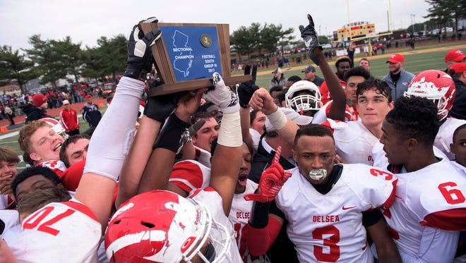 Delsea celebrates a 29-28 victory over Woodrow Wilson, earning a South Jersey Group 3 title Saturday, Dec. 2, 2017 at Rowan University in Glassboro, New Jersey.