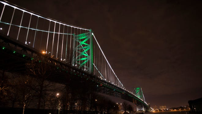 The Ben Franklin Bridge is lit green in support of the Philadelphia Eagles Thursday, Jan. 11, 2018 ahead of their Saturday afternoon playoff tiltÊagainst the Atlanta Falcons in Philadelphia.