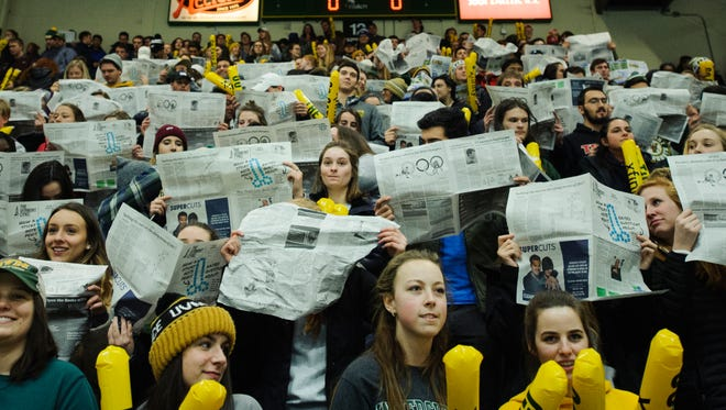 Students hold up newspapers as the UMass Lowell player are introduced during the men's hockey game between the UMass-Lowell River Hawks and the Vermont Catamounts at Gutterson Fieldhouse on Friday night January 19, 2018 in Burlington.
