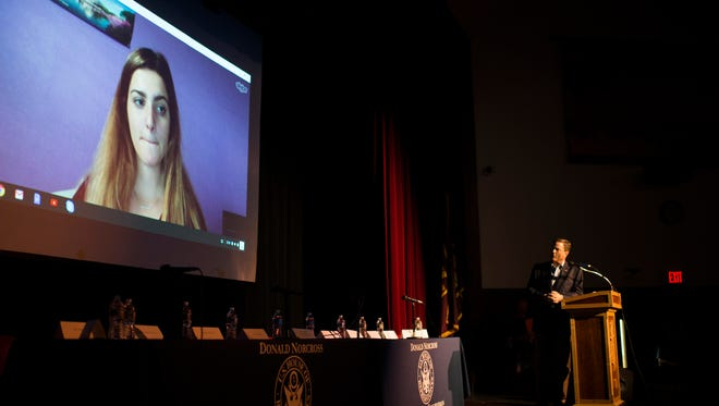 Congressman Donald Norcross, right, speaks wit Parkland shooting survivor via Skype during a gun safety town hall Tuesday, May 29, 2018 at Haddon Heights High School in Haddon Heights, N.J.