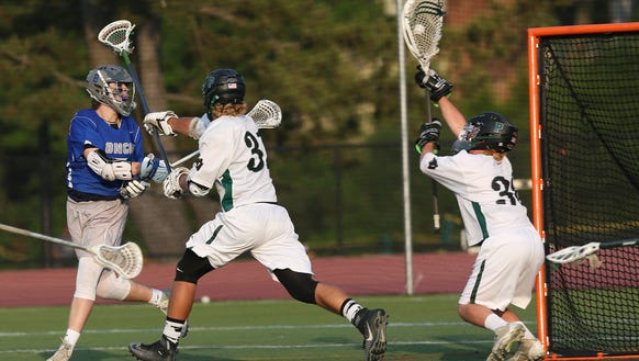 Pleasantville goalie Jack Fitzgerald stops a shot from