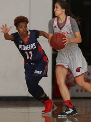 Simpson University's Savanna Fernandez looks to pass the ball past University of Antelope Valley's Daziah Pounds in the Redhawks' 81-55 loss on Thursday.