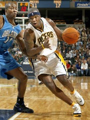 Indiana's Jermaine O'Neal drives to the basket in first