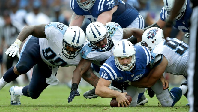 Andrew Luck falls on his own fumble after he was sacked by the Tennessee Titans defense in the third quarter of their game  Sept. 27, 2015 at Nissan Stadium in Nashville, Tenn.