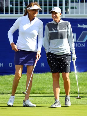 Caitlyn Jenner (left) and Abby Wambach (right) share a laugh on the ninth green while playing together in the ANA Inspiration Pro-Am Wednesday, March 30, 2016, at Mission Hills Country Club in Rancho Mirage, Calif.