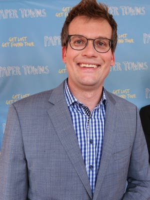 """""""Paper Towns"""" author John Green, right, joins the fun on the red carpet during the """"Paper Towns"""" movie tour at Old National Centre, Tuesday, July 14, 2015.  The """"Get Lost Get Found"""" tour begins in Indianapolis, hometown of author John Green, and stops at two other sites in the US before opening in theaters July 24."""