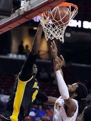 Wicomico's Derrick Hayward, dunks on a Calvert opponent during the 2013 2A state semifinal at the Comcast Center in College Park.