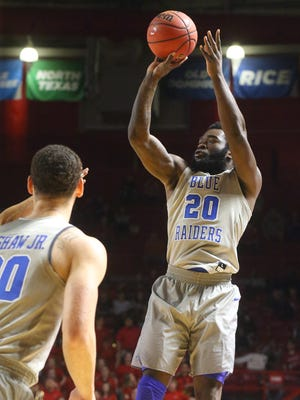 MTSU's Giddy Potts (20) attempts a 3-point-shot during the game against WKU, on Thursday, Feb. 16, 2017, at Bowling Green.