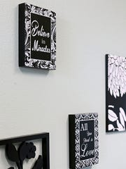 Positive messages of love and faith adorn Julie's office,