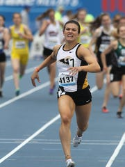 Southeast Polk senior Sydney Milani races to the finish