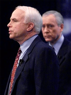 Sen. John McCain talks to the crowd gathered at a Republican presidential town meeting at Dartmouth College in Hanover, N.H., in 1999. Sen. Orrin Hatch, R-Utah, is shown looking on.
