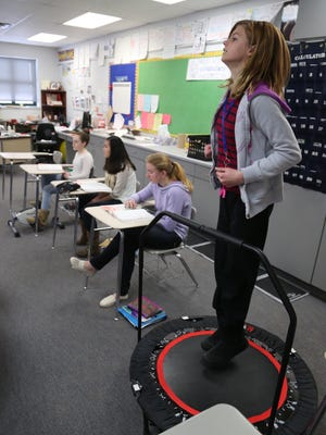 Cheyanne Hanaman bounces on a miniature trampoline on Friday during Amy Akey's math class at Horace Mann Middle School in Wausau.