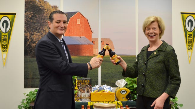 Sen. Ted Cruz, left, made good on his bet with Sen. Tammy Baldwin following the Packers' victory over the Cowboys.