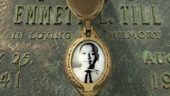 Emmett Till's photo is seen on his grave marker in