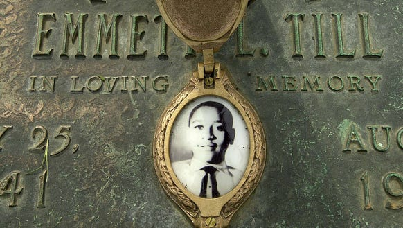 Emmett Till's photo is seen on his grave marker in