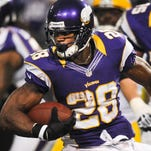 Vikings running back Adrian Peterson (28) tries to elude a tackle by Packers linebacker Clay Matthews during a 2012 game at the Metrodome.