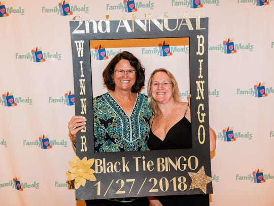 Shelley Adams and Cindy Southard were winners at the second annual Black Time Bingo event benefiting Family Meals.