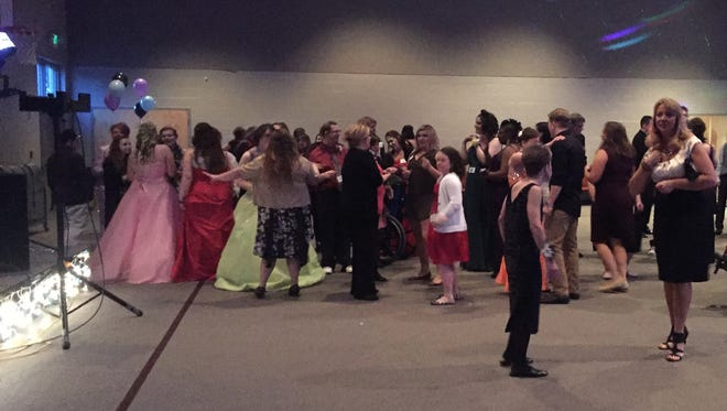 "A crowd takes to the dance floor at a past ""Night to Shine"" prom."