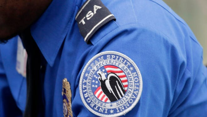 A Transportation Security Administration shoulder patch is shown Oct. 30, 2014, on the uniform of an officer at John F. Kennedy International Airport in New York.