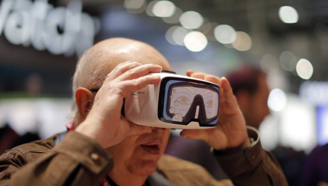 A man tries out some VR goggles during the recently concluded Mobile World Congress in Barcelona, Spain, where VR/AR took center stage.