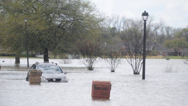 North Bossier was hit by heavy rains causing flooding in streets and communities.