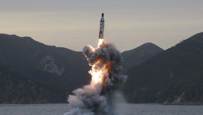 Undated photo released in 2016 of a North Korean test  of submarine ballistic missile.