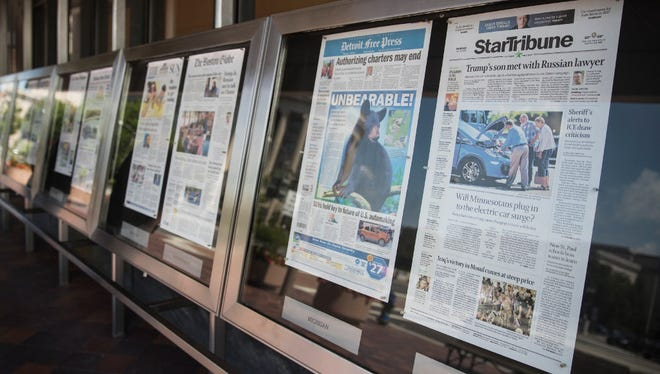 Newspaper front pages are displayed at the Newseum in Washington, D.C.