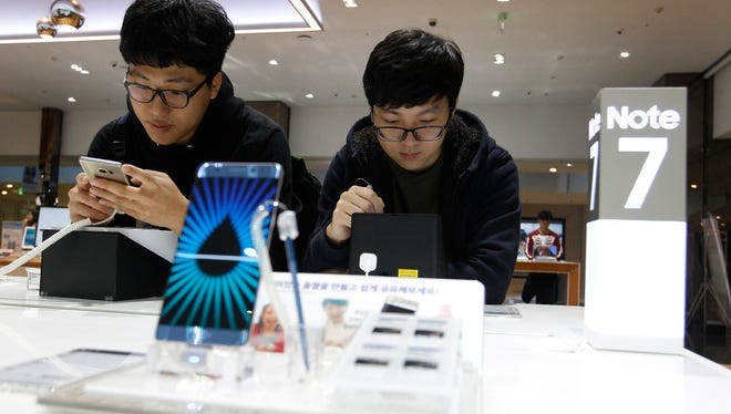 In this Monday, Oct. 10, 2016, file photo, South Korean high school students try out Samsung Electronics Galaxy Note 7 smartphones at the company's shop in Seoul, South Korea. At an event in NYC Wednesday, Samsung is expected to launch its newest Note.