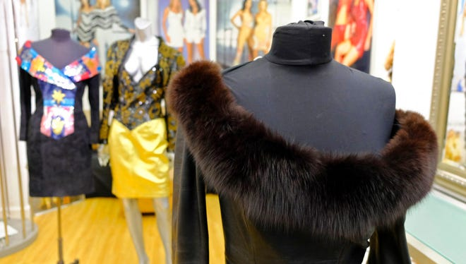 In this photo taken Thursday, March 15, 2018, a dress with a fox fur collar is displayed in the basement of West Coast Leathers in San Francisco. San Francisco could become the largest U.S. city to ban the sale of fur items.