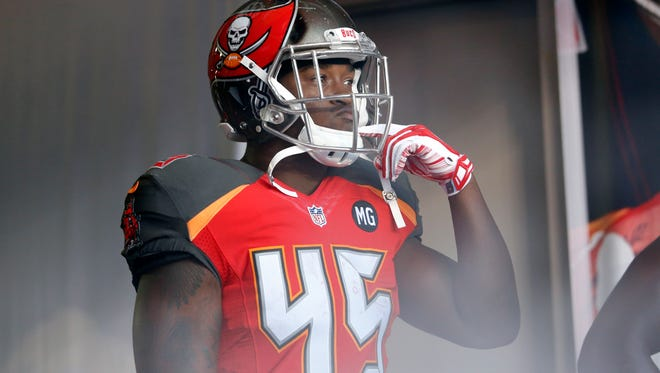 Tampa Bay Buccaneers running back Lonnie Pryor waits in the tunnel at the start of a preseason NFL game against the Washington Redskins on Aug. 28, 2014, in Tampa.