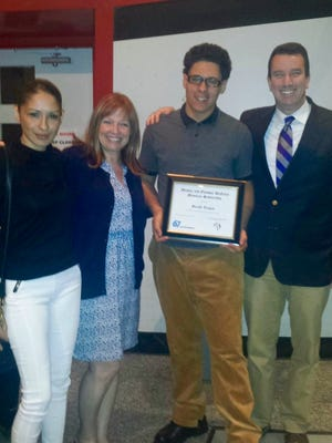 The inaugural 67 Foundation's Michael and Olympia DeNittis Memorial Scholarship for $1,000 recently went to Gerald Vargas, second from right, a senior at Woodbridge High School. He is pictured with his mother, Eleticia, Guidance Counselor Janet Engle, and Vice Principal Matthew Connelly.