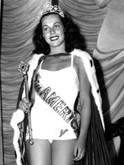 Bess Myerson, of New York, holds the scepter after