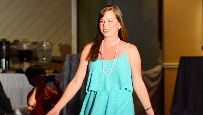 Betsy in a mint lace dress from Gibson Girl at the Pensacola Yacht Club Fashion Show.