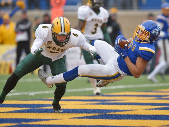 NDSU's James Hendricks (left) has 48 tackles for NDSU this season.