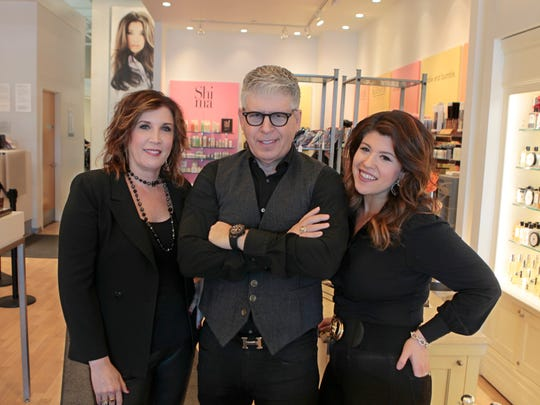 Scott Miller stands with wife, Helen, left, and daughter Alex, at his popular and always busy Scott Miller salon in Pittsford.