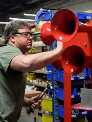 Keith Schermetzler assembles an omni-directional sound signal for mass notification at Kahlenberg Industries.