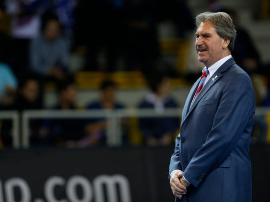 FILE - This is a Sunday, Nov. 13, 2016 file photo of International Tennis Federation (ITF) president David Haggerty stands as the public applauds in memory of victims of the Nov. 13, 2015 Paris Attacks, before the Fed Cup final in Strasbourg, eastern France. The Davis Cup and Fed Cup are planning to combine forces into a World Cup of Tennis. A three-year deal starting in 2018 to combine the events was announced Wednesday June 28, 2017, by the International Tennis Federation. The changes still need to be approved at the federation's annual general meeting in August in Vietnam. (AP Photo/Jean-Francois Badias/File)