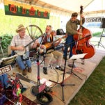 Wild Hog in the Woods play a John Prine song during E.Z. Orchards HarvestFest, Sunday, Oct. 4, 2015, in Salem, Ore.